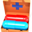 Stock Photo: First-aid set with pills