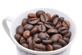 Grains of coffee are in a cup — Stock Photo