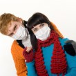 Man embraces a woman wearing masks, flu — Stock Photo #3963841