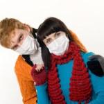 Man embraces a woman wearing masks, flu — Stock Photo
