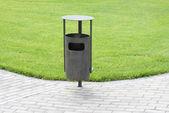 Green grass, refuse bin — Stock Photo