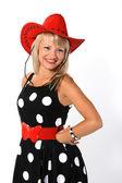 Krásná mladá dívka v červeném klobouku — Stock fotografie