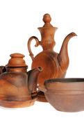 Old ceramic, clay teapot on the white — Stock Photo