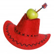 Green apple with a dart in a red hat on the white — Stock Photo #4181358