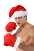 Sexy muscular man boxer wearing a Santa Claus hat — Stock Photo