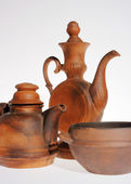 Old ceramic, clay teapot on the grey — Stockfoto