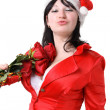 Woman in a red suit and hat of Santa Claus with red roses — Stock Photo #4298446