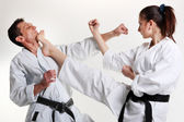 Karate. Young girl and a men in a kimono. Battle sports capture — Stock Photo