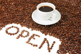 "Cup with coffee, coffee grain, and inscription ""open"" from coffe — Stock Photo"