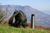 Backpack and thermos — Stock Photo