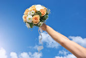 Bouquet in hand — Stock Photo