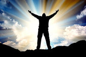 Silhouette of man and sunshine — Stock Photo