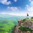 Girl on the peak of mountain - Stock Photo