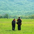 Tourists in mountain meadow — Foto Stock