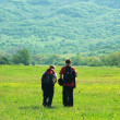 Tourists in mountain meadow — Stok fotoğraf