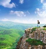 Girl on the peak of mountain — Stock Photo