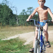Innocent little kid on bicycle — Stock Photo