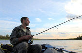Men fishing with spinning — Stock Photo