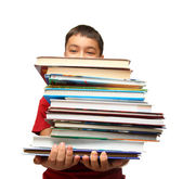 Asian boy with stack of books — Stock Photo
