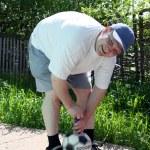 Man pump soccer football ball — Stock Photo