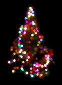 Christmas fir with defocused lightings — Stock Photo