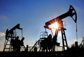 Two oil pumps silhouette — Stock Photo