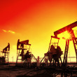 Working oil pumps silhouette in row - Stock Photo