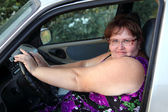 Overweight woman behind the wheel — Stock Photo