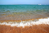 Sea waves and gold sand beach — Stock Photo