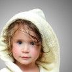 Cute girl in bathrobe portrait — Stock Photo