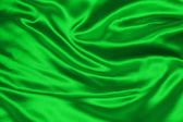 Green crumpled silk fabric — Stock Photo