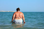 Overweight woman bath in sea — Stock Photo