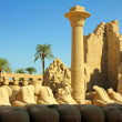 Column and statues of sphinx in karnak temple - Stock Photo
