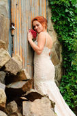 Bride near the old locked door — Stock Photo