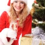 Christmas tree and santa girl — Stock Photo #4293319