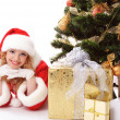 Christmas tree and santa girl - Stock Photo