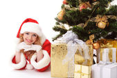Christmas tree and santa girl — Stock Photo