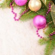 Christmas gold and pink with pine branch — Stock Photo