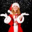 Christmas santa girl on black — Stock Photo #4406426