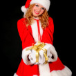 Christmas santa girl on black — Stock Photo