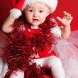 Girl santa on red cloth — Stock Photo