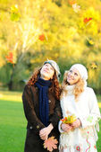 Two girl under the maple tree — Stock Photo