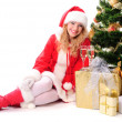 Christmas tree and santa girl — Stock Photo #4412411