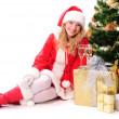 Christmas tree and santa girl — Stock Photo