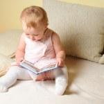 Girl reading a book — Stock Photo #4412491