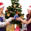 Two Christmas santa girl with gift — Stock Photo