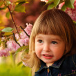 Stock Photo: Little girl in garden