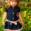 Little girl in garden — Stock Photo #4726874