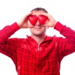 Man with red heart-shapes — Stock Photo