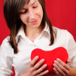 Teenage girl with red heart shape — Stock Photo
